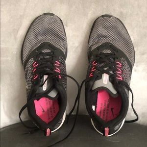 Gray and pink Nike's